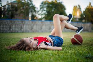 depth of field sports jerseys women model outdoors women outdoors grass ball jean shorts lying on back on the floor basketball sneakers