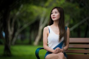 depth of field women outdoors model women looking into the distance white tops asian bench sitting necklace