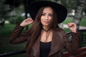 dmitry sn long hair hat brown jacket hair in face smiling portrait model jacket looking at viewer women black tops leather jackets open jacket millinery