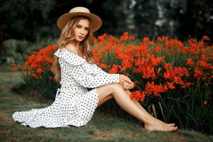 dress model sitting viktoria manko necklace looking at viewer women outdoors barefoot women blonde flowers women with hats on the floor