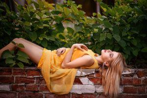 dress plants women outdoors bricks leaves model yellow dress women lying on back outdoors depth of field blonde