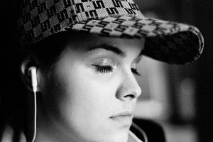 earphones baseball cap photography closed eyes julo kotus women portrait face film grain monochrome