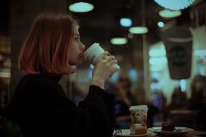 evening women coffee redhead