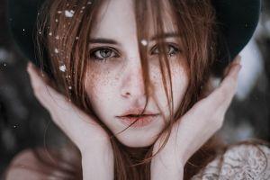 face model women outdoors freckles hat hands depth of field women brunette closeup looking at viewer