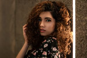 face touching hair model bokeh looking at viewer curly hair indoors dress portrait women brunette women indoors