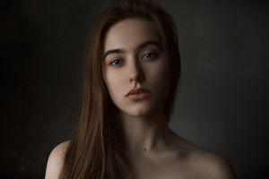 face women indoors dark background women long hair indoors brunette bare shoulders ilya baranov looking at viewer model portrait