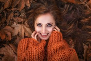 fall leaves sweater women portrait smiling face model