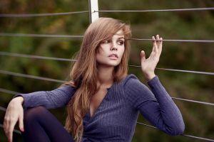 fence anastasia scheglova sitting bokeh sweater brown eyes women depth of field blue sweater