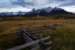 fence mountains landscape