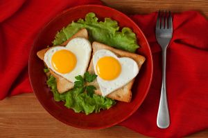 food heart (design) wooden surface fork salad eggs toast
