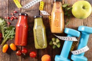 food kiwi (fruit) smoothie mint leaves vegetables tomatoes numbers pomegranate apples wooden surface dumbbells lettuce fruit