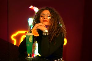 glasses watch neon drinking glass women with glasses women indoors lights women portrait curly hair neon lights black tops indoors looking at viewer model