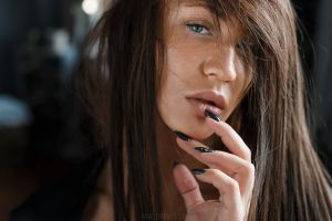 hair in face portrait face women looking at viewer finger on lips closeup blue eyes long eyelashes painted nails black nails