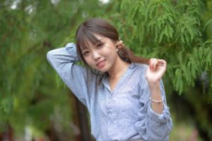 hands in hair brunette women brunette women outdoors asian pearl earrings brunette smiling striped clothing