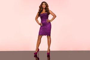 hands on hips dress reflection high heels pink background ebony tv personality brunette