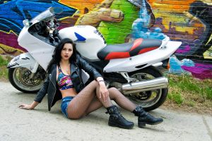 honda leather jackets women jean shorts sitting black jackets shoes women with motorcycles graffiti fishnet stockings