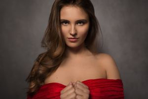 ilya baranov gray background long hair bokeh red dress women bare shoulders sensual gaze looking at viewer dress indoors hands women indoors face portrait