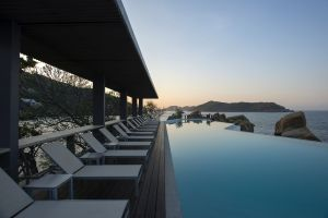 island swimming pool resort deck chairs sea
