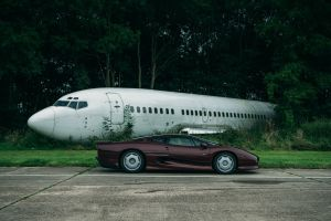 jaguar xj220s forest airplane