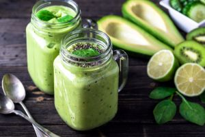 kiwi (fruit) fruit spoon lemons spinach avocado glass