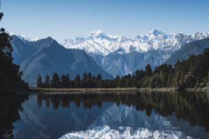 lake trees reflection mountains new zealand