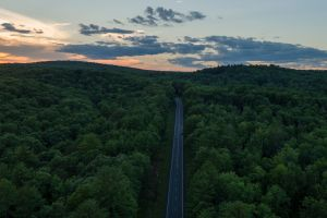 landscape clouds aerial view forest sun hill usa highway sunset nature road trees