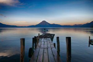 landscape pier guatemala mountains clear sky boat