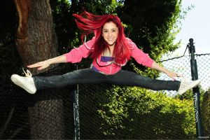 leaves fence women ariana grande smiling women outdoors stretching model long hair sneakers redhead trees jeans jumping singer