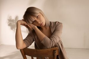 lingerie chair gray eyes portrait wall brunette sitting women blonde
