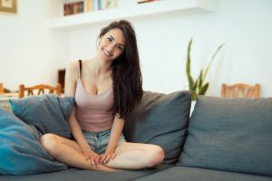living rooms sitting looking at viewer open mouth women indoors smiling luigi malanetto model hoop earrings nicole (model)  cleavage happy couch tank top cushions