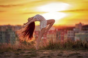 long hair city dancing arched back legs redhead depth of field women outdoors women