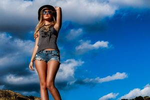 long hair clouds necklace women outdoors model sky blue women with hats outdoors tank top blonde jean shorts standing women women with shades sky