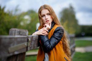long hair fence women outdoors maksim romanov yellow jacket portrait women