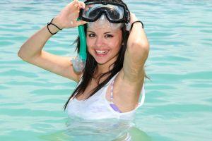 long hair women water tank top selena gomez singer brunette wet body wet clothing face smiling brown eyes armpits goggles