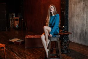 looking at viewer barefoot sitting model sewing machine portrait vlad popov long hair indoors wooden floor hair in face depth of field women blue sweater women indoors