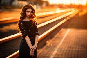 looking at viewer lipstick women women outdoors sunlight bracelets sun rays sunset depth of field urban skirt model redhead