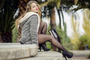 looking at viewer looking over shoulder grey jacket legs women pantyhose blonde lip gloss jacket sitting high heels red lipstick