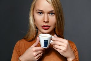 looking at viewer red lipstick dark background portrait sarika a painted nails darina nikitina coffee cup model face hands blonde gray eyes coffee women
