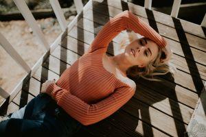 looking at viewer women blonde torn jeans alysha nett necklace women outdoors model lying on back bare shoulders