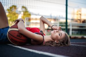 looking away ball depth of field women outdoors basketball watch lying on back women jean shorts on the floor model sports jerseys outdoors basketball court pierced nose