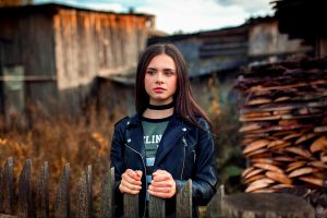 looking away fence model teen  women t-shirt brown eyes depth of field brunette ksenia sirotkina leather jackets black jackets necklace aleksandr suhar outdoors