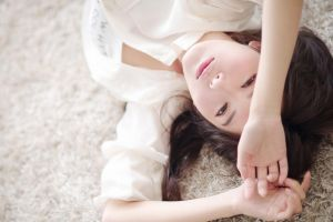 lying on back white skirt model asian arms up brunette looking at viewer women photography