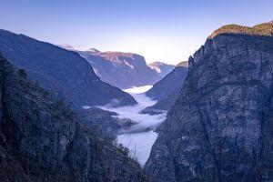 mist gorge clear sky mountains