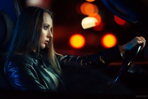 model black jackets looking into the distance women with cars brunette women driving inside a car evgeny bulatov profile car interior leather jackets night