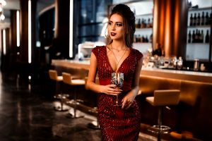 model fashion red lipstick necklace drinking glass women looking away glass restaurant brown eyes long hair red nails red dress blonde lipstick