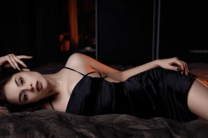 model in bed black dress looking at viewer women indoors portrait women brown eyes depth of field ivan sheremet dark dress brunette black nails indoors