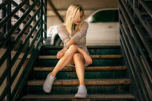model sitting blonde legs crossed women stairs