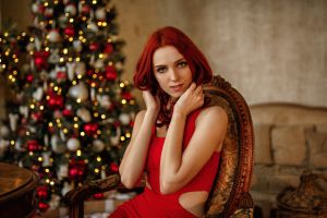 model smiling portrait sitting dress table chair redhead red dress looking at viewer indoors bokeh christmas tree christmas women indoors