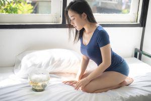 model window women fishbowls in bed kneeling barefoot asian