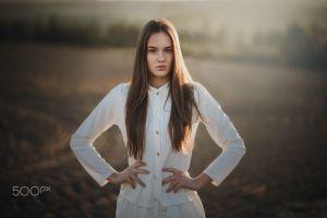 model women brunette women outdoors white shirt sunlight long hair 500px hands on hips